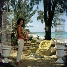 Gloria Schiff, the twin sister of Consuelo Crespi, with her pet dog and pet birds at Lyford Cay in the Bahamas. (Photo by Slim Aarons) Note this image is available as an Open Edition or Limited Edition Estate Stamped Print (edition size Abstract Photography, Artistic Photography, Portrait Photography, Fashion Photography, Digital Photography, Photography Ideas, Jet Set, Slim Aarons Prints, Serpieri