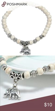 WHITE ELEPHANT BRACELET! •Super cute elephant bracelet •stretch •silver elephant charm •white beads Words To Live By Apparel Jewelry Bracelets