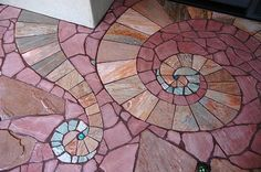 Lance JordanMosaico con azulejo y piedra....