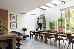 Architect Seth Stein has tweaked the existing conservatory giving it a more graceful roofline.Light box  The owners of this Victorian townhouse in west London have decorated the classically proportioned rooms in plain and simple finishes to create the perfect setting in which to display their collection of modern design.
