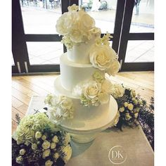 """""""#regram of our cake for Claire & Delu from @dianekhouryweddingsandevents xxx The cake is all real and the sugar flowers were custom hand made to fit in…"""""""