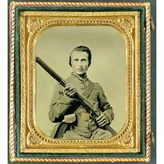 Unidentified soldier in Confederate uniform and Louisiana state seal belt buckle with musket.  The Liljenquist Family Collection; Library of Congress.