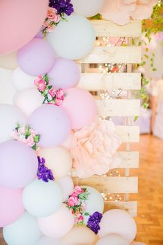 Floral Balloon Garland + Pallet Board Backdrop from a Pastel Garden Birthday Party on Kara's Party Ideas