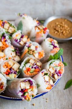 Tofu rice paper rolls make a delicious, light lunch or a starter. They're fresh, vegan and gluten-free and come with a killer date & peanut sauce.