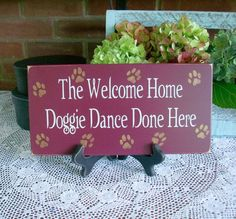The Welcome Home Doggie Dance Wood Sign Painted. $14.95, via Etsy.
