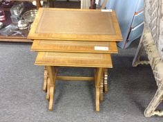 Nested Tables - Three nested tables with leather insert tops.  Beautiful condition.  Item 287-12.  Price $180.00.   - http://takeitorleaveit.co/2013/11/18/nested-tables/