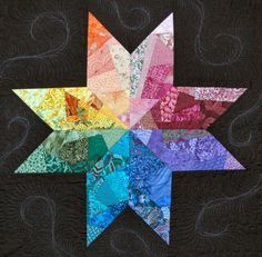 """Crazy Lonely Star, is made by simply crazy piecing onto a lightweight fabric foundation cut into 18"""" diamonds"""