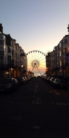 Brighton Wheel, Brighton, England — by Eat Sleep Shoot Travel. Loving this view from the street of the Brighton Wheel , UK