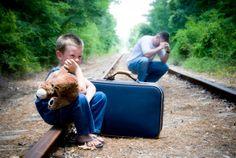 Desperate man and child on train tracks