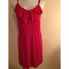 Red plus size dress Red plus size dress with ruffle neck and adjustable spaghetti straps. Elastic waist. Very comfortable. Size is 3X. Sorry, not interested in trades. Dresses
