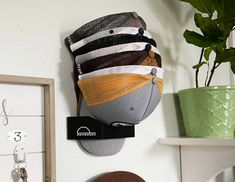Do you collect ball caps? This smartly-designed, minimal rack lets you store up to 15 hats on your wall. Simply place your first cap in the DomeDock Ball Cap Storage, Hat Storage, Baseball Cap Rack, Diy Hat Rack, Hat Holder, Mens Gear, Gadget Gifts, Mens Caps, Hats For Men