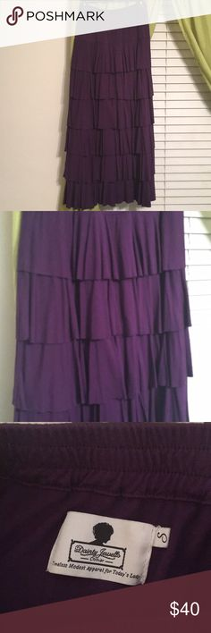 Dainty Jewels purple ruffle skirt Excellent condition. Like new. Only washed and worn 3 or so times. IMO could fit a small as well as a medium, because of elastic waist. Super pretty royal purple color. Reasonable offers considered. Will not go much lower as hasn't been worn much at all. Dainty Jewels Skirts Maxi