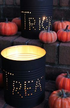 Trick or treat spray paint tin coffee jars black and poke holes in it and tea light candle to set out with pumpkins