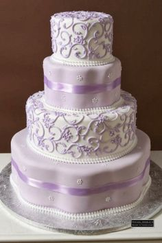4 Layers wedding cake pale lavender and white/ www.volusiacountyweddingflowers/ www.callaraesfloralevents.com