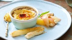 Vanilla crème brûlée with prosecco-spiked peaches