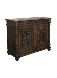 This stately 19th Century French Louis XIV Walnut Marble Top Buffet makes the ideal choice for any room in the home or office, with timeless hand-carved detail, the luxury of sumptuous French walnut, and a carefree yet elegant marble top, complemented by cast bronze drawer pulls and keyguards.     TheHighBoy    #highboystyle #antiquesmakeitbetter #antiques #vintagefurniture #midcenturymodern #homedecoration