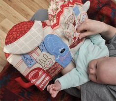 embroidered soft book for baby -- with pockets for fox and bunny to slide in and out.  love this!   Marie Mrnavkova