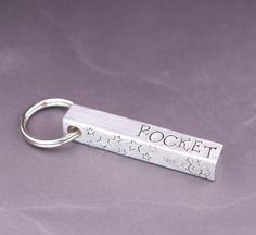 This personalized bar dog tag is hand stamped just for you and your dog!  This original dog tag is handcrafted at The Dancing Hound's studio. Each letter and image is carefully hand stamped into the metal, one letter at a time. The tag is then filed smooth, tumbled, hand colored, and polished. This tag ships to you fully assembled, and ready to install on your dog's collar or harness. #thedancinghound Custom Dog Tags, Dog Id Tags, Metal Bar, Pet Names, Hand Coloring, Hand Stamped, Your Pet, Dancing, My Etsy Shop