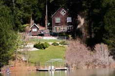 1,792 sf, 2BR/2,5BA lake home on Hayden Lake with a boat dock.Level to gentle slope lawn to waters edge and dock. Open floor plan great room/dining with lake views. Laminate floors & pellet stove. Third bedroom off master suite could be sitting room, both with lake views. Open deck and spa hot tub overlooks lawn, fire pit, dock and Hayden Lake. Fenced yard, raised garden beds, garden shed & shop/play house.