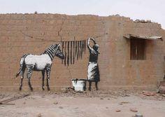 Banksy is a pseudonymous England-based graffiti artist, political activist, film director, and painter. His satirical street art and subversive epigrams combine irreverent dark humour with graffiti. Banksy Graffiti, Street Art Banksy, Street Art Utopia, Graffiti Artwork, Graffiti Drawing, Bansky, Banksy Canvas, Urban Graffiti, Banksy Artist