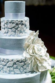 gorgeous pale blue wedding cake with large white flower by mishelle handy cakes wedding design by judy lehmbeck photo by aaron kapor kapor kapor kapor