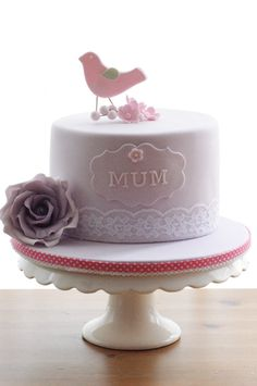 Oh! That's a cute cake. For my mom I would make it in blue though.. and without fondante. So entirely different :P