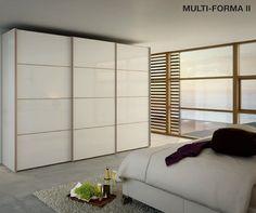 Hulsta Multi-Forma Design L schuifdeurkast lak hoogglans wit,4 lak kleuren, panelen,vijf houtuitvoeringen, japans disign,verre oosten,Slaapkenner Theo Bot: kast op maat