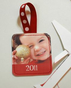 Photo of each foster child and the year they lived in your house. crafterhours: Fast, Easy, Inexpensive, Cute Photo Ornaments: A Tutorial