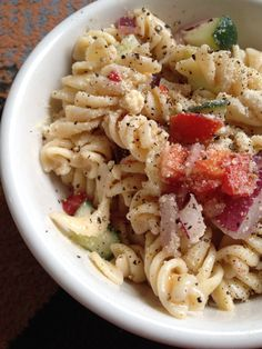 "Pasta salad I made. Ummmmm  Ingredients: 1 box rotini pasta 1 bottle Italian dressing (preferably Newman own Northern Italian with basil) 1 cucumber 1/2 large red onion 1 large tomato Fresh black pepper  Cook pasta in salted water. Drain and allow to cool (rinse in cold water) combine additional ingredients.  Adding shrimp gives it an ""extra"" flavor"