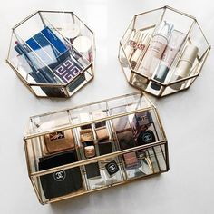 A chic way to store your makeup. Mix and match glass boxes for an eclectic look.