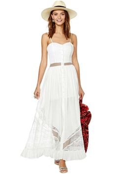 Channel your goddess energy in this white maxi dress! It has a sheer mesh panel at waist, button closures at front, and lace detailing at skirt. Wear it with ankle boots and a fringe bag! By Jarlo. White Maxi Dresses, White Dress, Summer Dresses, Summer Maxi, White Lace, Lace Beach Wedding Dress, Wedding Dresses, Gypsy, Maxi Dresses
