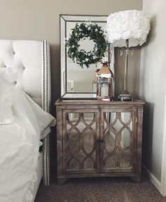 Rustic mirrored nightstand. Addyson living mirrors with wreath. Shabby chic lamps. Bronze lantern. Modern farmhouse style
