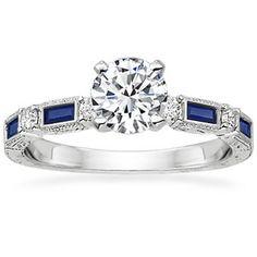 Diamond ring with little TARDIS-blue sapphires!