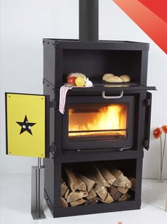"""Made by the Danish, the """"Klassic"""" Wood Cook Stove is stylish, functional, and of course well built. The star side panels are available in a variety of colors to satisfy any style decor. #modernwoodcooking #europeanwoodcookstove #woodcooking #woodcookstove #woodbaking"""