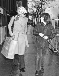 Jackie Onassis strolls Paris with her son after shopping, 1972.