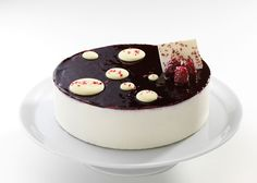 Black Mulberry Cake - Cream with Mascarpone cheese, black mulberry parfait and black mulberry mousse between cake layers with chocolate geno...