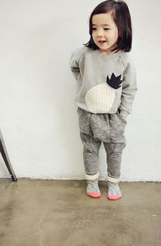 Cute minimal children's wear, with soft greys and pretty hints of colour like pink. Little girls outfit ideas.
