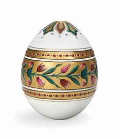 A RUSSIAN PORCELAIN EASTER EGG, PROBABLY BY THE IMPERIAL PORCELAIN FACTORY, CIRCA 1870. Of Pan-Slavic design, decorated in raised enamels with foliage reserved against a gilt ground, between two bands of dots.