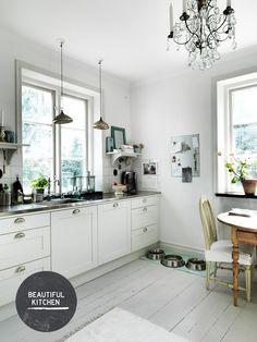 white walled home, white floor, white cabinets, kitchen