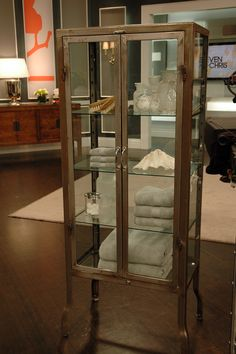 Restoration Hardware metal pharmacy cabinet....perfect for bathroom to hold towels, bath salts, lotions and more!