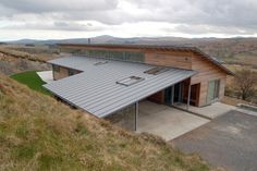 Simon Winstanley Architects completes The Houl, a net zero carbon and wind powered home in Scotland that meets Passiv Haus standards for insulation.