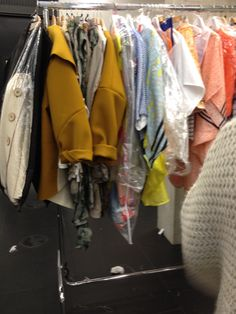 Theses are some of sammy's garments ready to go on the models for the showing. Placed in order of line up.