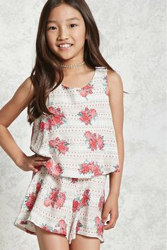 Forever 21 Girls - A layered woven romper featuring an allover floral and tribal-inspired print, a round neck, sleeveless cut, split-back design, snap-button shoulder strap closures, and an elasticized waist.