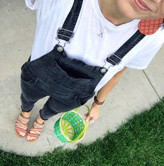 I love this modest fashion blogger and her cute everyday style. This post features black denim overalls and cute light weight coral leather earrings.