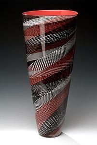 """""""Color Weave Cone"""" by Brian Becher. I love examples of excellent design as seen in this graphic vase of imposing stature.  Using thin rods of colored glass  Becher wraps, twists,  overlaps his parallel linear patterns in an unexpected diagonal direction creating a  sense of dynamic and uplifting movement, a hallmark of this remarkable technician and  artist."""" Michael Monroe"""