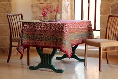Tablecloth, floral, colorful classic, festive cotton rectangular. Indian block print.  Block-printed fabric with bright multicolor (mainly red with yellow and green) traditional Rajistani floral motifs and a multi-color border. The dye is applied to hand-carved wooden blocks and pressed into the fabric. Thus each tablecloth is unique and reflects the beauty of a handcrafted design. It will brighten up your kitchen or dining room. Makes a great birthday or Mothers day gift. Can be machine…