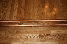 Wood Floor Inlay: Ideas for Faux Inlay Transition - Flooring Piclodge Living Room Flooring, Bedroom Flooring, Vinyl Flooring, Decorating Tips, Interior Decorating, Transition Flooring, Wood Ceilings, Wood Laminate, Wood Planks