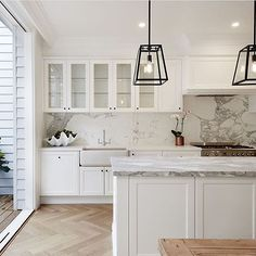 doors opening to terrace/porch/sunroom white cabinets - herringbone floor - move sink to island Home Interior, Kitchen Interior, New Kitchen, Kitchen Decor, Kitchen Black, Basement Kitchen, Shaker Kitchen, Kitchen Flooring, Kitchen Tiles