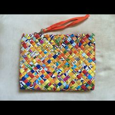 CLUTCH Yellow Orange Multi-Colored & Fair Trade Half the Sky Designs ClutchHandmade of Re-purposed Candy Wrappers by Women in the Philippines7 1/2 inches Top-Bottom9 1/5 inches Side-SideZip top envelope styleNo tradesNo paypalNo merc PLEASE USE THE OFFER BUTTON Fair Trade Bags Clutches & Wristlets