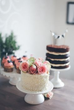 love the pink buttercream + blueberry cupcakes in the back - gorgeous. also love the bunting.